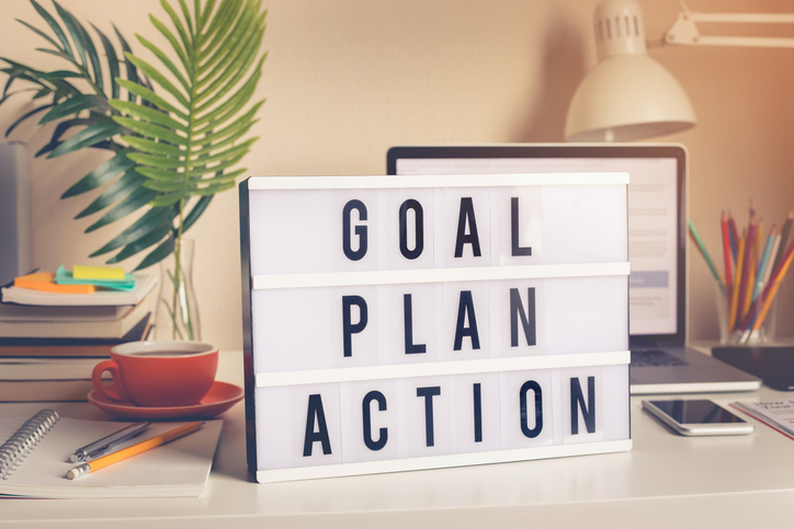 Goal,plan,action text on light box on desk table in home office.Business motivation or inspiration,performance of human concepts ideas (Goal,plan,action text on light box on desk table in home office.Business motivation or inspiration,performance of h
